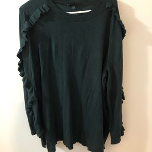 Hunter green sweater with ruffled sleeves.